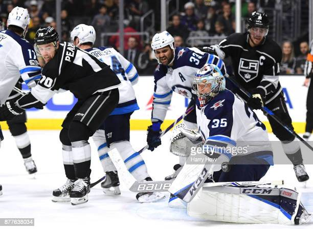 Steve Mason of the Winnipeg Jets makes a blocker save in front of Tanner Pearson of the Los Angeles Kings during the second period at Staples Center...