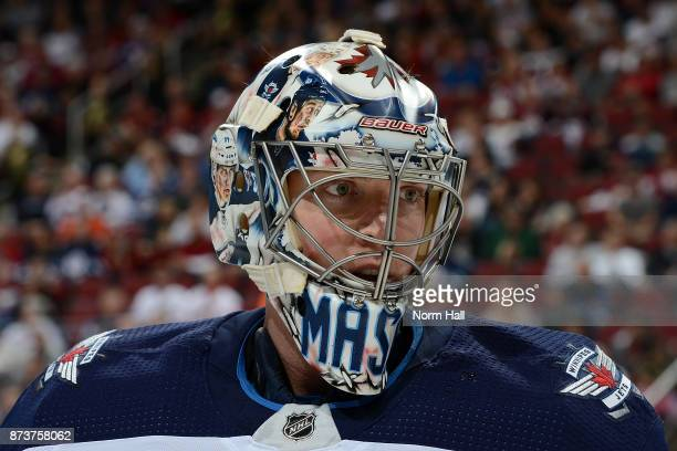 Steve Mason of the Winnipeg Jets skates to the bench during a stop in play against the Arizona Coyotes at Gila River Arena on November 11 2017 in...
