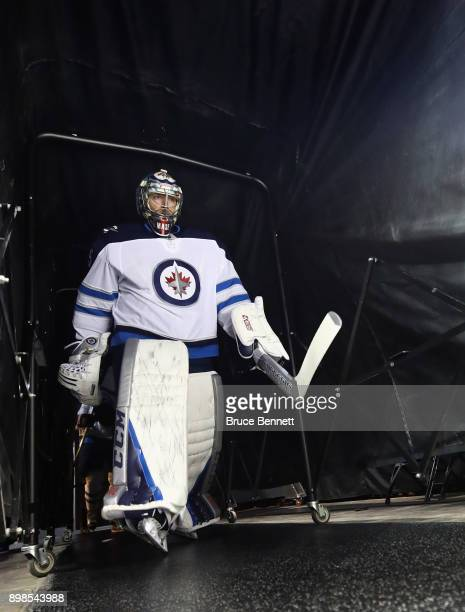 Steve Mason of the Winnipeg Jets walks out for warmups prior to the game against the New York Islanders at the Barclays Center on December 23 2017 in...