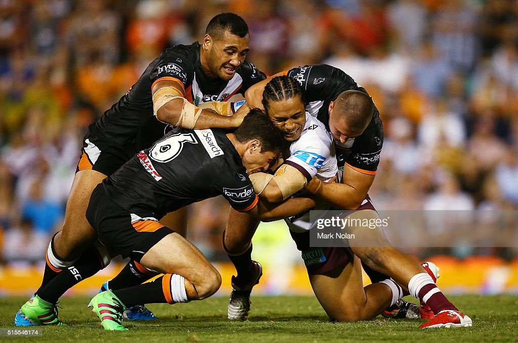Steve Matai of the Eagles is tackled during the round two NRL match between the Wests Tigers and the Manly Sea Eagles at Leichhardt Oval on March 14, 2016 in Sydney, Australia.