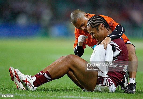 Steve Matai of the Eagles receives attention for a shoulder injury during the second NRL Preliminary Final match between the Manly Warringah Sea...