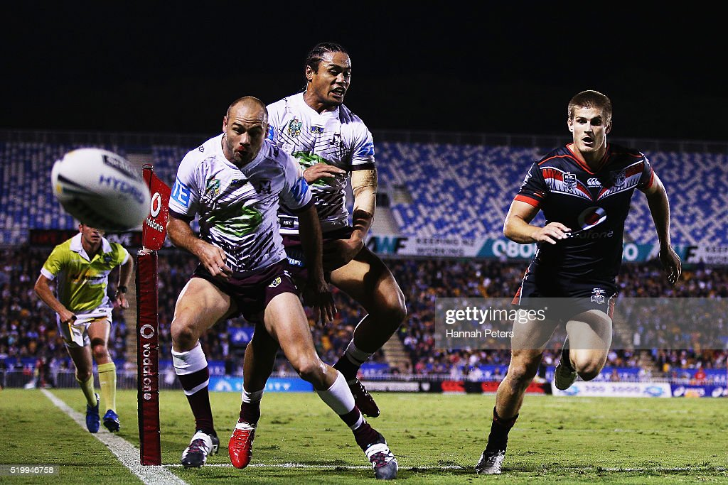 Steve Matai of the Sea Eagles and Brett Stewart of the Sea Eagles chase the ball down as Blake Ayshford of the Warriors chases through during the round six NRL match between the New Zealand Warriors and the Manly Sea Eagles at Mt Smart Stadium on April 9, 2016 in Auckland, New Zealand.