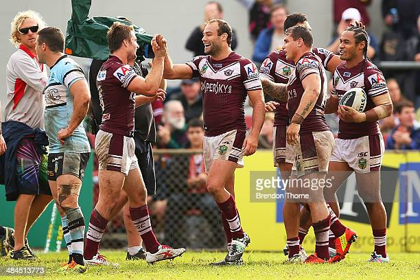 Steve Matai of the Sea Eagles celebrates with team mates after scoring a try during the round 6 NRL match between the ManlyWarringah Sea Eagles and...