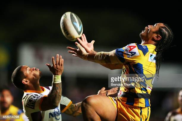 Steve Matai of the Sea Eagles competes with Josh Hoffman of the Broncos for a high ball during the round 21 NRL match between the ManlyWarringah Sea...
