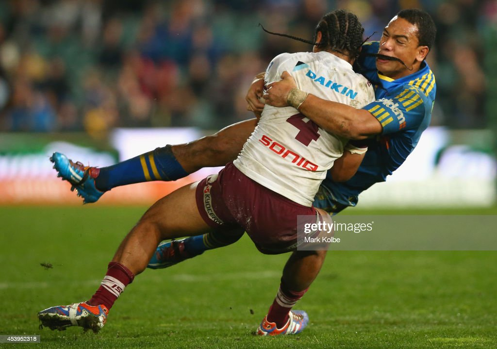 Steve Matai of the Sea Eagles is tackled by Will Hopoate of the Eels during the round 24 NRL match between the Parramatta Eels and the Manly Sea Eagles at Pirtek Stadium on August 22, 2014 in Sydney, Australia.