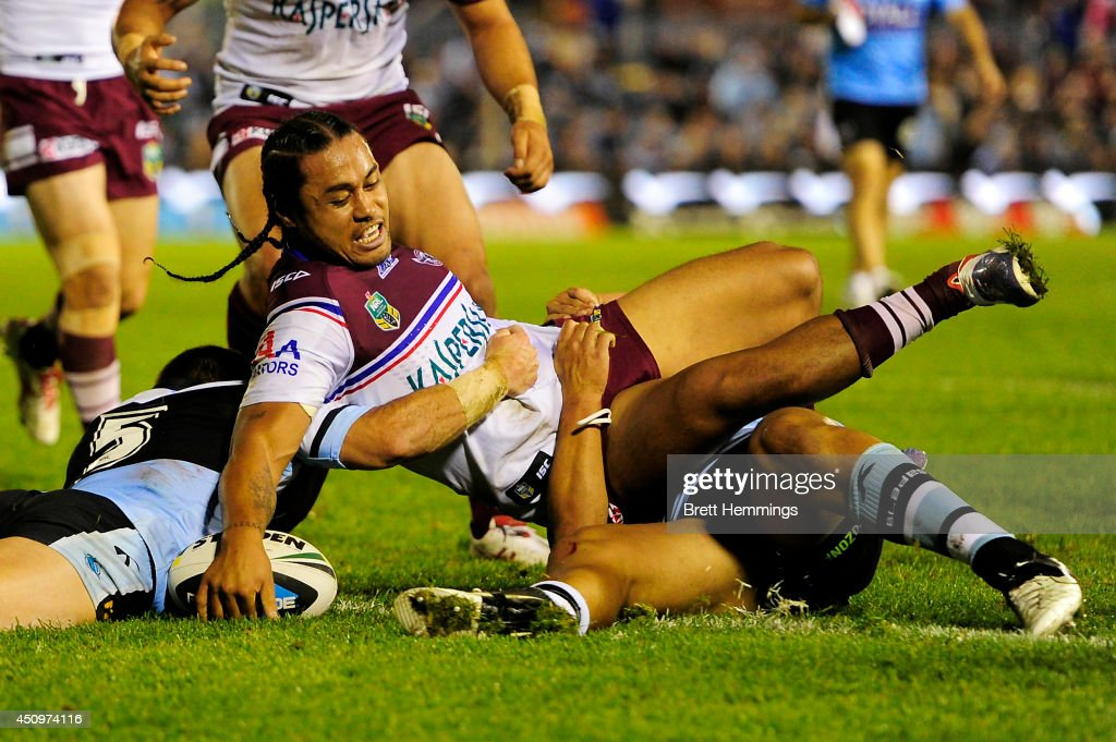 Steve Matai of the Sea Eagles scores a try during the round 15 NRL match between the Cronulla-Sutherland Sharks and the Manly-Warringah Sea Eagles at Remondis Stadium on June 21, 2014 in Sydney, Australia.
