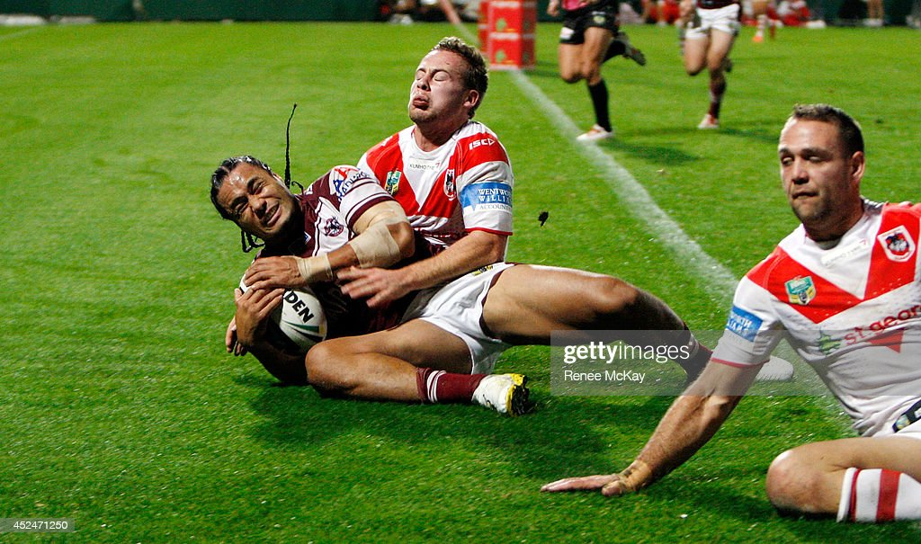 Steve Matai of the Sea Eagles scores a try in the tackle of Adam Quinlan of the Dragons during the round 19 NRL match between the St George Dragons and the Manly Sea Eagles at WIN Jubilee Stadium on July 21, 2014 in Sydney, Australia.