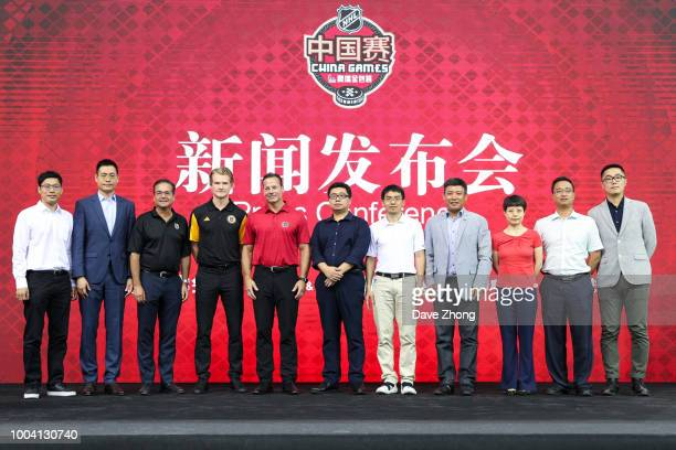 Steve Mayer Danton Heinen Martin Gelinas William Wang Jin Fei Wang Meng and other guest pose for group photo during a press conference before the...