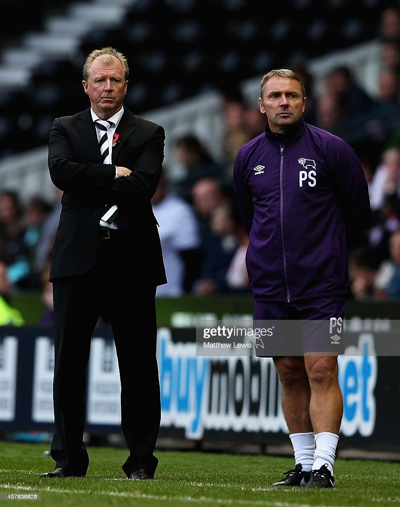 Steve McClaren, manager of Derby County and Paul Simpson, First Team Coach look on during the Sky Bet Championship match between Derby County and Wigan Athletic at the iPro Stadium on October 25, 2014 in Derby, England.
