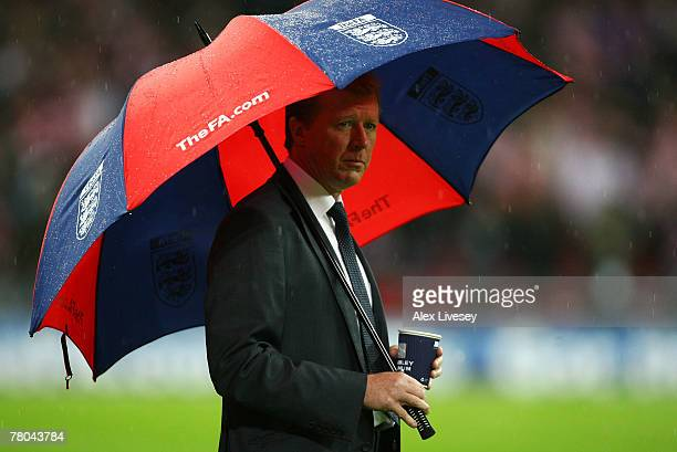 Steve McClaren manager of England looks on from under his umbrella prior to the Euro 2008 Group E qualifying match between England and Croatia at...