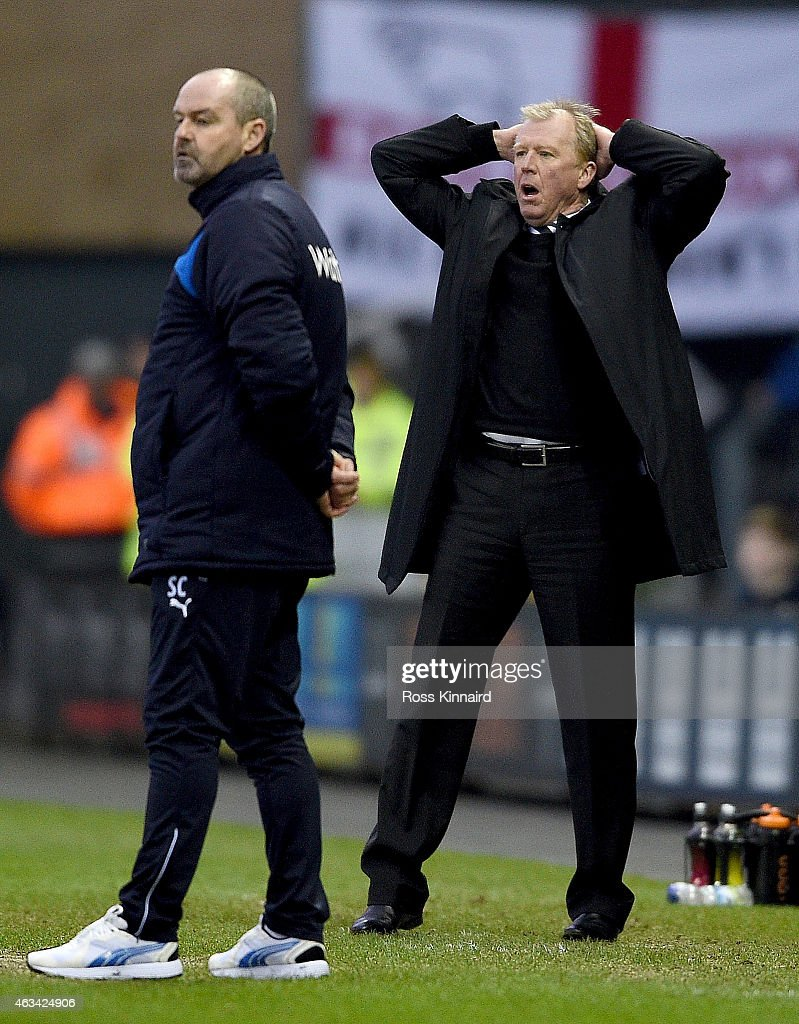 Steve McClaren the manager of Derby and Steve Clarke the mamager of Reading on the touch line during the FA Cup fifth round tie between Derby County and Reading at iPro Stadium on February 14, 2015 in Derby, England.