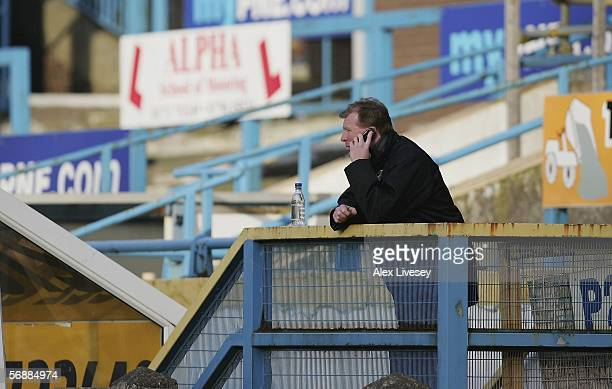 Steve McClaren the manager of Middlesbrough makes a phone call as he watches the game from an empty stand during the FA Cup Fifth Round match between...