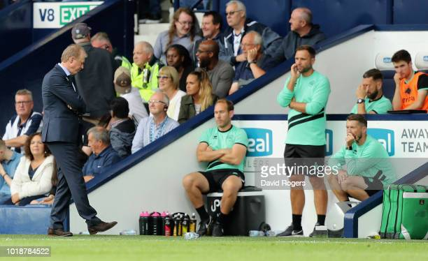 Steve McClaren the Queens Park Rangers manager and his coaching staff look dejected during their 71 defeat in the Sky Bet Championship match between...