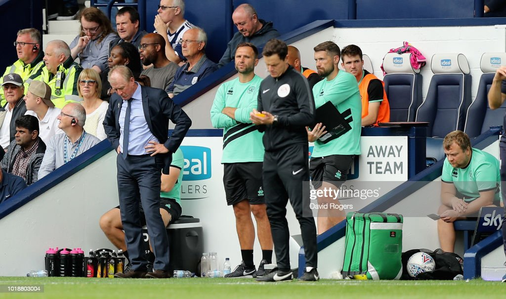 Steve McClaren, (L) the Queens Park Rangers manager looks dejected with his coaching team during their 7-1 defeat in the Sky Bet Championship match between West Bromwich Albion and Queens Park Rangers at The Hawthorns on August 18, 2018 in West Bromwich, England.
