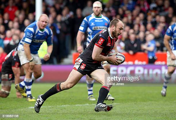 Steve McColl of Gloucester Rugby breaks through to score a try against Newport Gwent Dragons during the European Rugby Challenge Cup match between...