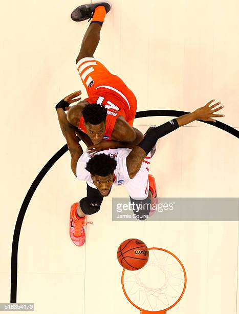 Steve McElvene of the Dayton Flyers and Tyler Roberson of the Syracuse Orange battle for position in the first half during the first round of the...