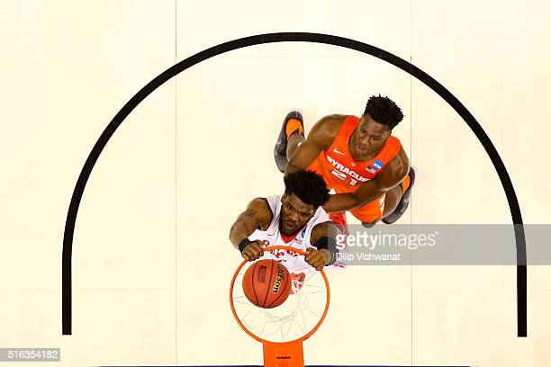 Steve McElvene of the Dayton Flyers dunks against Tyler Roberson of the Syracuse Orange in the first half during the first round of the 2016 NCAA...