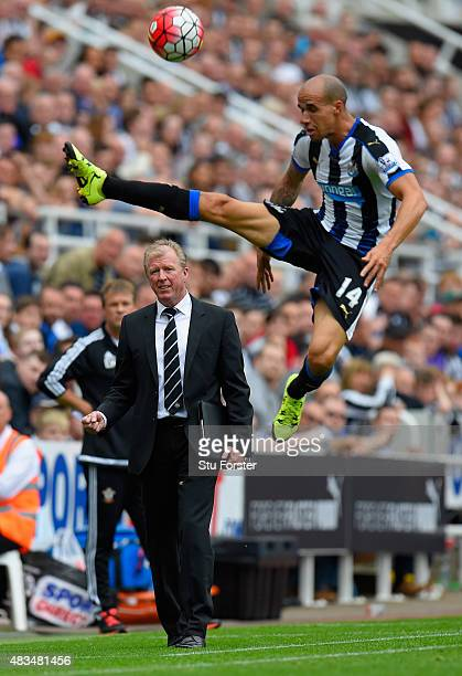Steve McLaren manager of Newcastle United looks on as Gabriel Obertan of Newcastle United jumps for the ball during the Barclays Premier League match...