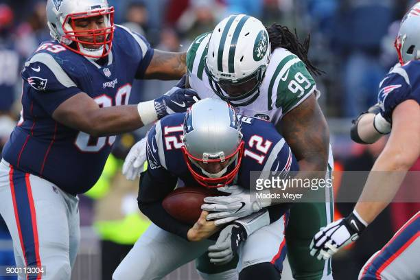 Steve McLendon of the New York Jets sacks Tom Brady of the New England Patriots during the second half at Gillette Stadium on December 31 2017 in...