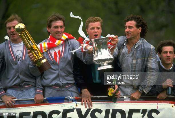 Steve McMahon Kenny Dalglish Steve Nicol Craig Johnston and Jim Beglin all of Liverpool stand on the top of their homecoming bus with the FA Cup and...