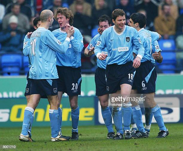 Steve McManaman celebrates Manchester City's third goal with Antoine Sibierski during the FA Barclaycard Premiership match between Bolton Wanderers...