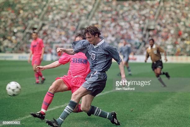 Steve McManaman crosses for England in a Century Challenge Cup match against Hong Kong Golden Select XI at the Happy Valley Stadium Hong Kong during...