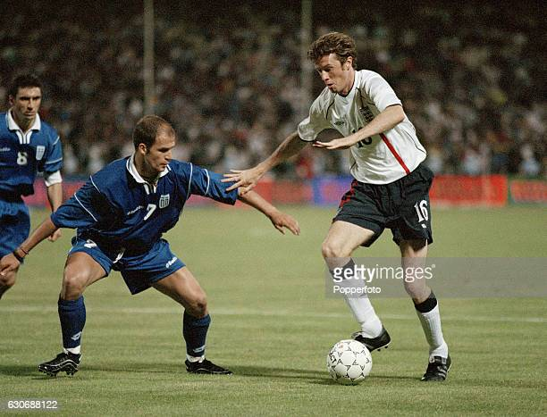 Steve McManaman of England moves past Angelos Basinas of Greece during the World Cup Qualifying match between Greece and England in Athens on 6th...