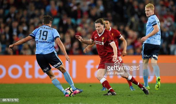 Steve McManaman of Liverpool competes with George Blackwood of Sydney FC during the International Friendly match between Sydney FC and Liverpool FC...