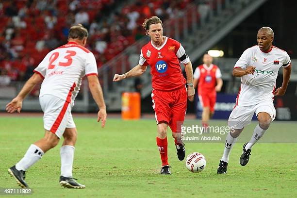 Steve McManaman of Liverpool dribbles past Quinton Fortune of Manchester United during The Castlewood Group Battle Of The Reds 2015 between Liverpool...