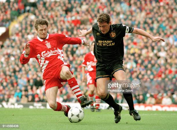 Steve McManaman of Liverpool tackles Steve Bruce of Manchester United during an FA Carling Premiership match at Anfield on March 19 1995 in Liverpool...