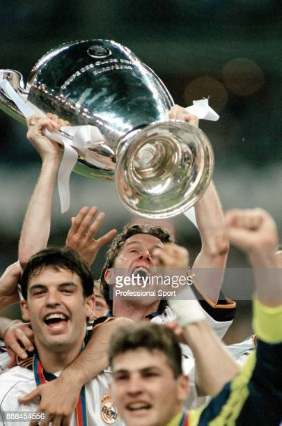 Steve McManaman of Real Madrid celebrates with team mate Fernando Morientes while lifting the European Cup after victory in the UEFA Champions League...