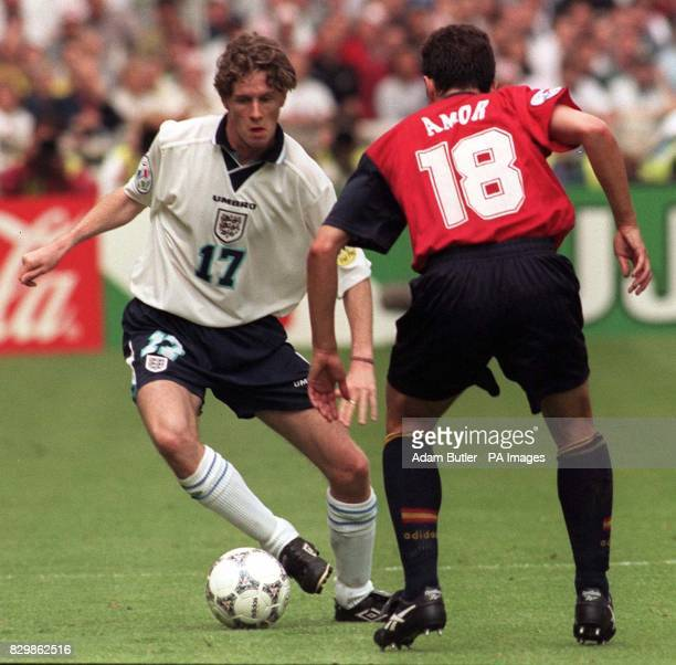 Steve McManaman swerves to avoid Guillermo Amor during today's Euro 96 quarter final clash against Spain at Wembley Photo by Adam Butler/PA