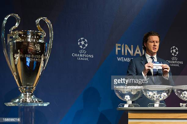 Steve McManaman UEFA Champions League Final Ambassador shows the name Manchester United during the UEFA Champions League round of 16 draw at the UEFA...