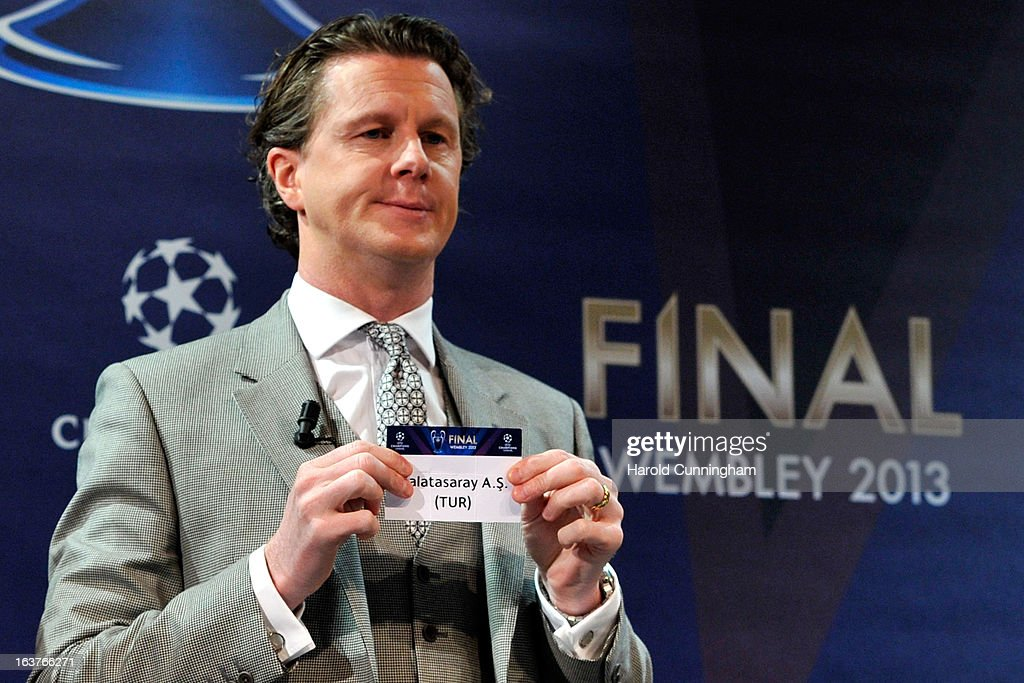 Steve McManaman, UEFA Champions League Final Ambassador, shows the name Galatasaray AS during the UEFA Champions League quarter finals draw at the UEFA headquarters on March 15, 2013 in Nyon, Switzerland.