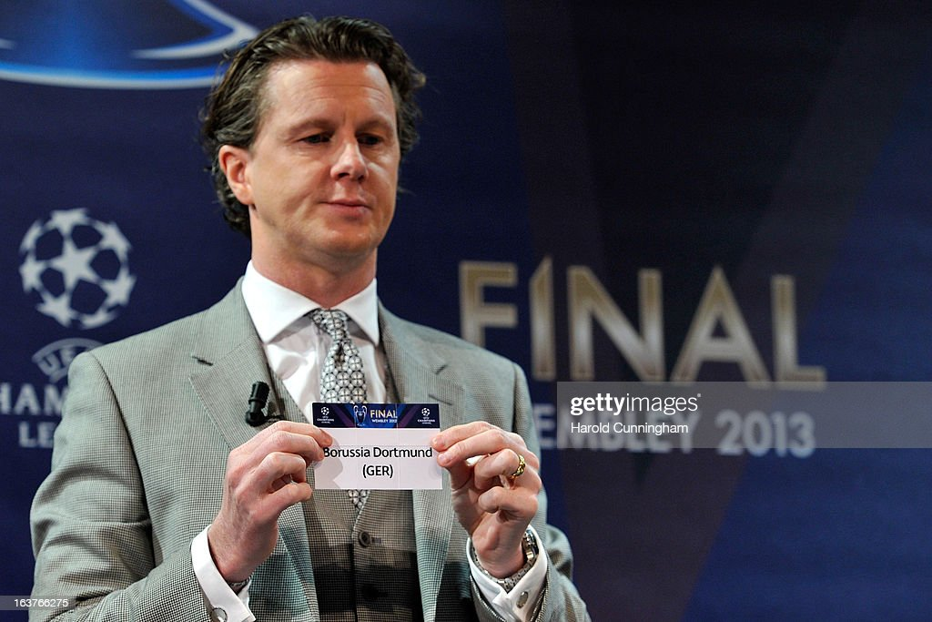 Steve McManaman, UEFA Champions League Final Ambassador, shows the name Borussia Dortmund during the UEFA Champions League quarter finals draw at the UEFA headquarters on March 15, 2013 in Nyon, Switzerland.