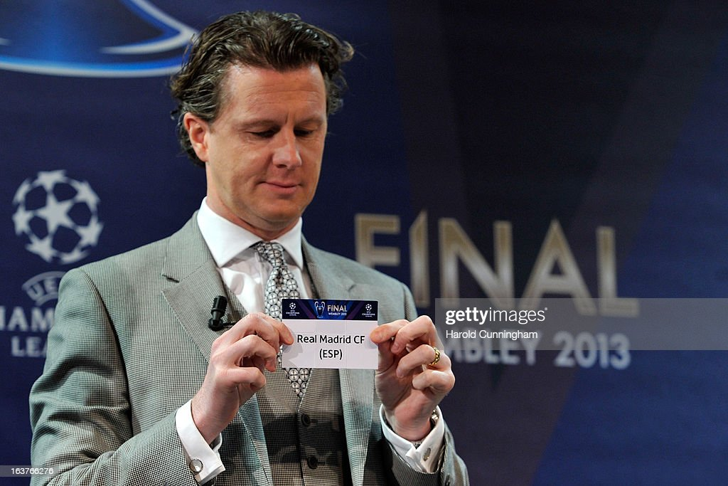 Steve McManaman, UEFA Champions League Final Ambassador, shows the name Real Madrid CF during the UEFA Champions League quarter finals draw at the UEFA headquarters on March 15, 2013 in Nyon, Switzerland.