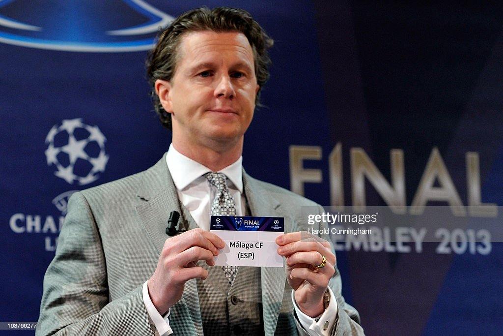 Steve McManaman, UEFA Champions League Final Ambassador, shows the name Malaga CF during the UEFA Champions League quarter finals draw at the UEFA headquarters on March 15, 2013 in Nyon, Switzerland.