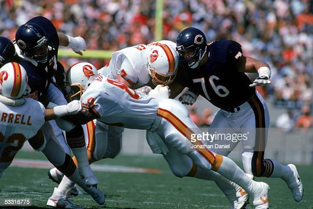 Steve McMichael of the Chicago Bears rushes against Ron Heller of the Tampa Bay Buccaneers while Jimmie Giles blocks Mike Hartenstine during the game...