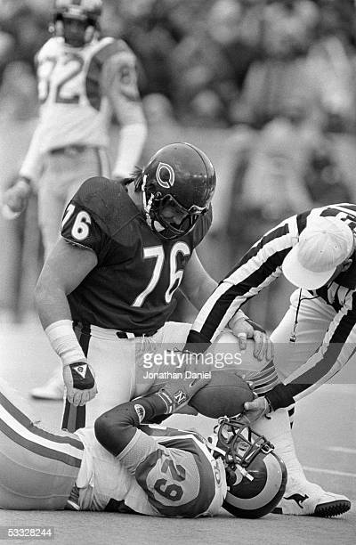 Steve McMichael of the Chicago Bears tackles Eric Dickerson of the Los Angeles Rams during the 1985 NFC Championship game at Soldier Field on January...