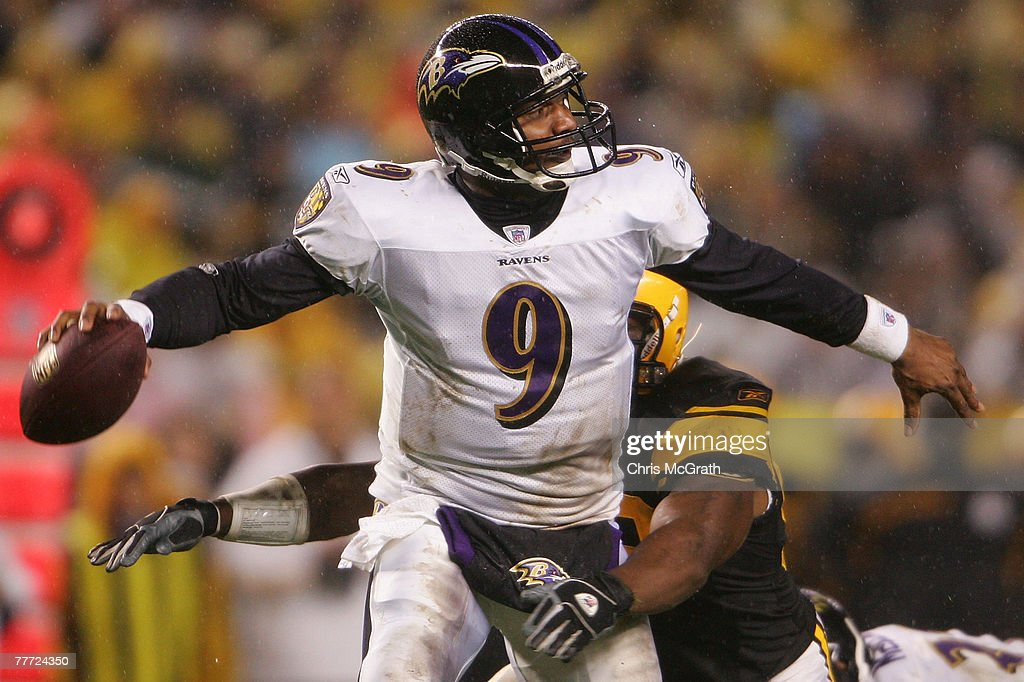 3accc314e88 Steve McNair of the Baltimore Ravens is sacked by James Harrison of ...