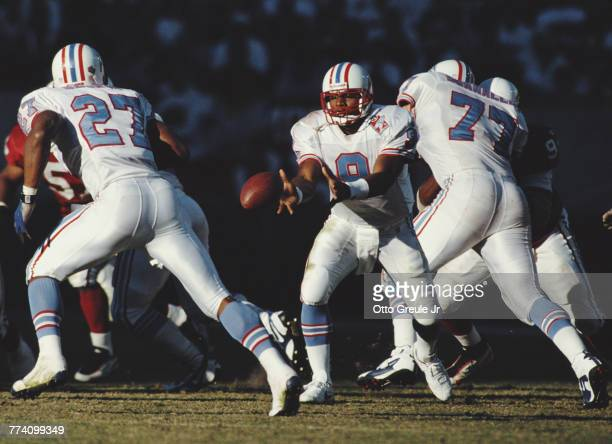 Steve McNair Quarterback for the Tennessee Oilers passes the ball to Running Back Eddie George during the National Football Conference East game...