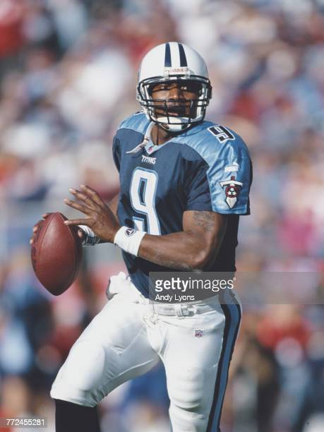 Steve McNair Quarterback for the Tennessee Titans runs the ball during the American Football Conference Central game against the Pittsburgh Steelers...
