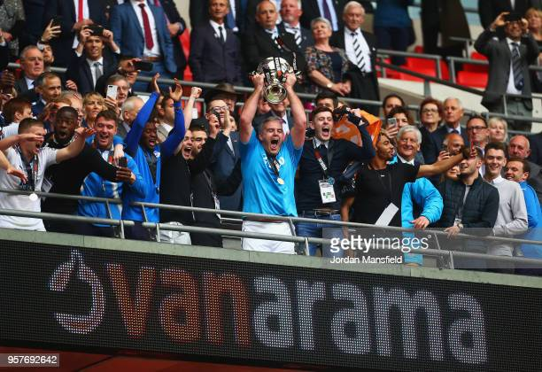 Steve McNulty of Tranmere Rovers lifts the trophy with team mates as they celebrate victory after during the Vanarama National League Play Off Final...