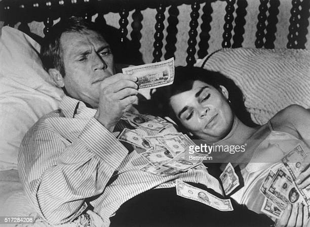 Steve McQueen and Ali McGraw in a scene from the 1972 movie 'The Getaway' McGraw and McQueen are lying in bed with a pile of money