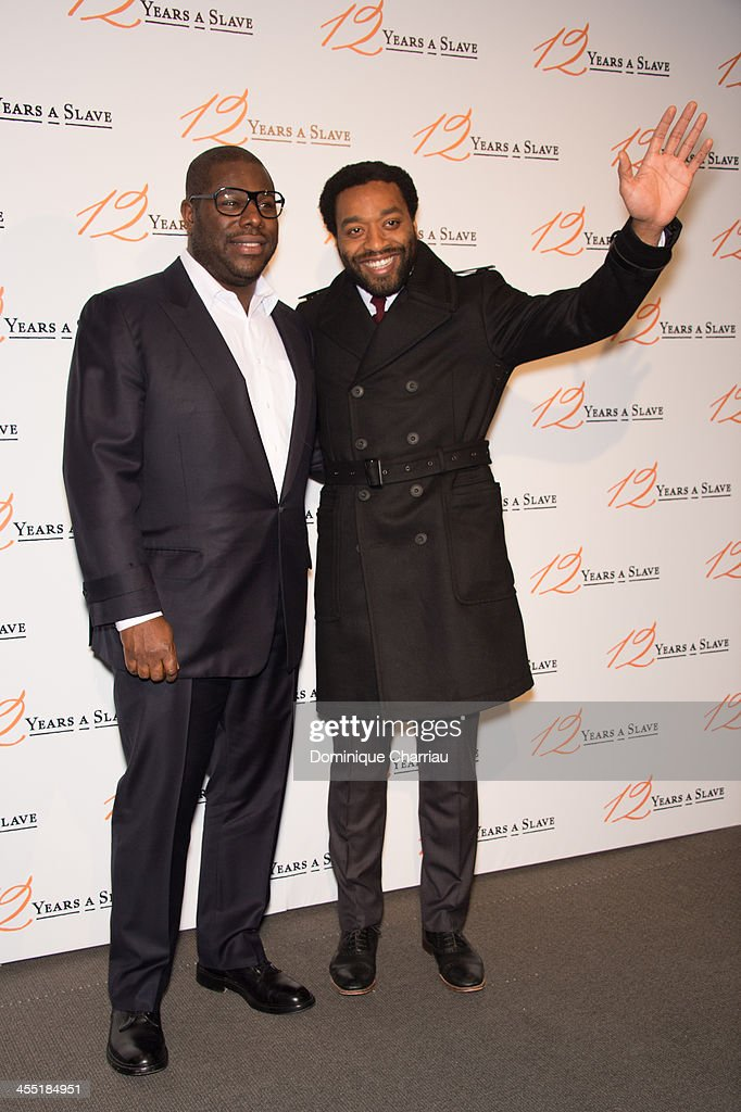 Steve McQueen and Chiwetel Ejiofor attend the '12 Years A Slave' Paris premiere at Cinema UGC Normandie on December 11, 2013 in Paris, France.