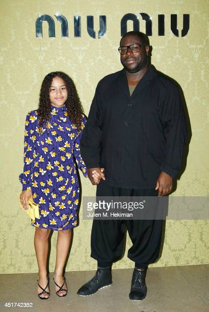 Steve McQueen and dauhter Alex McQueen attend the Miu Miu Resort Collection 2015 at Palais d'Iena on July 5 2014 in Paris France