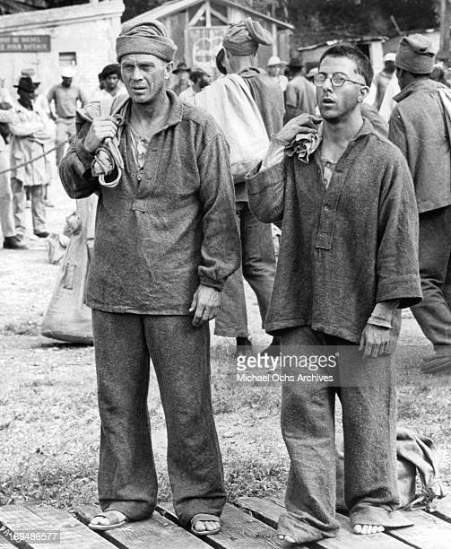 Steve McQueen and Dustin Hoffman are fellow convicts imprisoned at French Guiana in a scene from the film 'Papillon' 1973