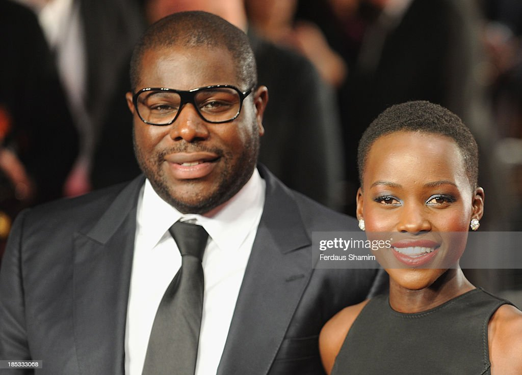 Steve McQueen and Lupita Nyong'o attend the European premiere of 'Twelve Years A Slave' during the 57th BFI London Film Festival at Odeon Leicester Square on October 18, 2013 in London, England.
