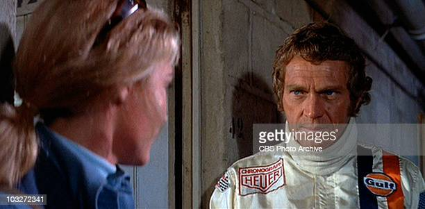 Steve McQueen as race car driver Michael Delaney talking to Elga Andersen as Lisa Belgetti in the movie Le Mans 1971 Image is a frame grab