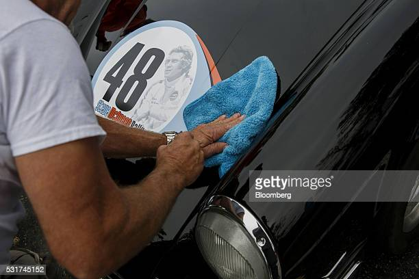 A Steve McQueen decal is applied to a 1970 Porsche 911S coupe hot rod sports purpose modified car during the Friends of Steve McQueen Car Show Rally...
